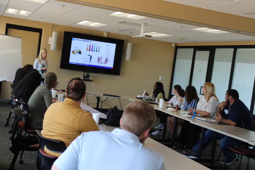 Students learning about Amway